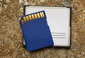 picture of memory stick  - Blue compact memory cards for camera on soil background - JPG