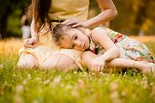 pic of caress  - Mother is caressing her worried child outdoor in nature - JPG