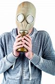 pic of gas mask  - A young man wears a gas mask isolated over a white background - JPG