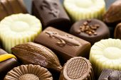 image of truffle  - Delicious chocolate truffles and candy on a dark background - JPG