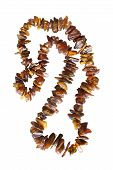 pic of beads  - String of amber beads on white background - JPG