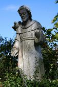 stock photo of funeral home  - lovely saint watching over a cemetary garden - JPG