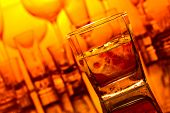 stock photo of whiskey  - whiskey with natural ice on glass table in bar