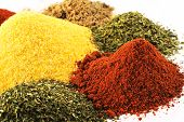 stock photo of chili peppers  - Close up of an assortment of different spices - JPG