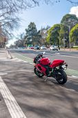 picture of motorcycle  - Beautiful red sport motorcycle is standing on the sidewalk in Melbourne - JPG