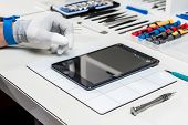 pic of stolen  - Technician replacing a used tablet - JPG