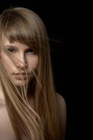 picture of gothic hair  - serious young woman with long hair in dark - JPG