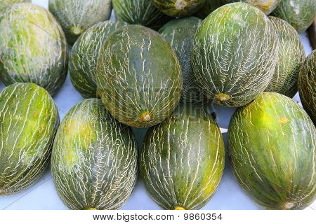 Piel De Sapo Santa Claus Melon Stacked Rows Fruit