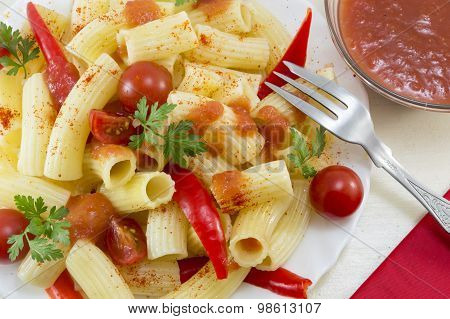 Pasta With Cherry Tomatoes And Red Pepper Served With A Tomato Sauce And A Fork, Close Up