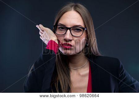 Portrait of woman smudging lipstick