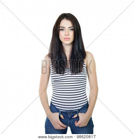 Studio portrait of young woman in blue jeans with long dark hair, over white background.