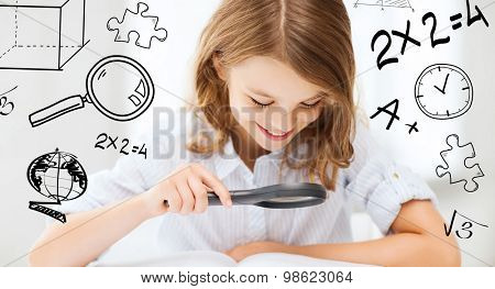 education and school concept - little student girl reading book with magnifier at school