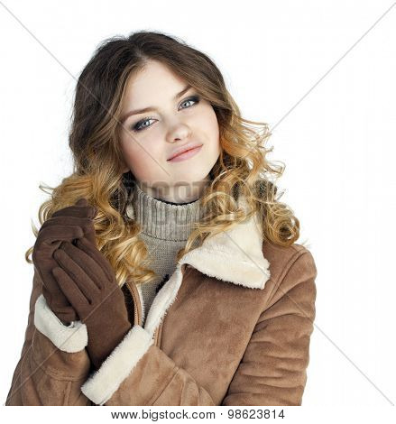 Young beautiful girl in a leather sheepskin coat, isolated on white background