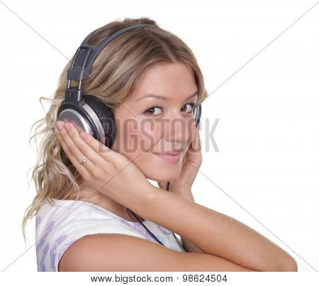 Happy young blonde woman listening to music, isolated on white