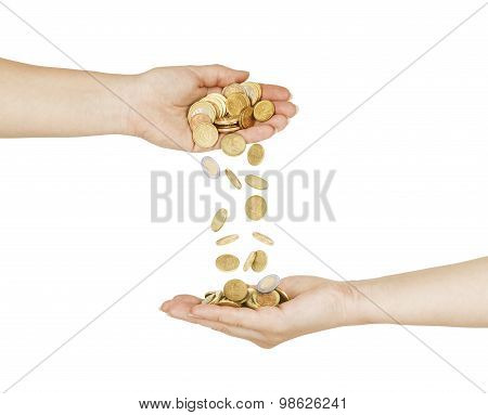 Female Hand Pour Down Coins Into Hands Of Another Person. With Clipping Path