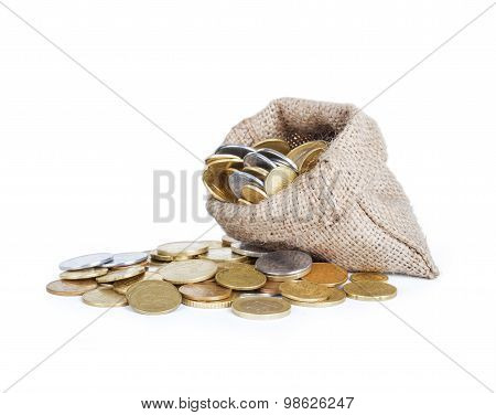 Gold Coins Fall Out Of A Canvas Bag On White Background