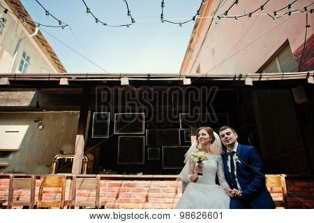 Wedding Couple Sitting At Pub