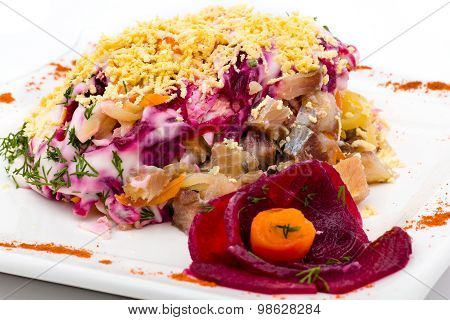 Salad with salted herring, potato, beet, carrot and mayonnaise