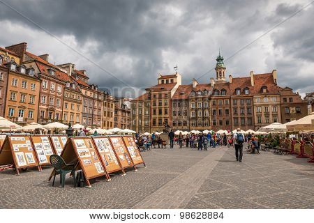 WARSAW, POLAND - JUNE 20, 2015:  Sale painting in old Town Market Place in June 20, 2015 in Warsaw, Poland. UNESCO World Heritage Site