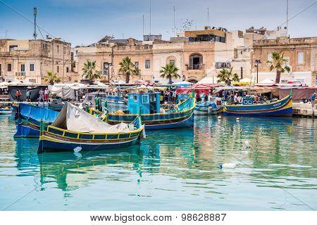 MARSAXLOKK HARBOR, MALTA - MAY 24: Fishing boats in Marsaxlokk harbor. Malta on May 24, 2015.