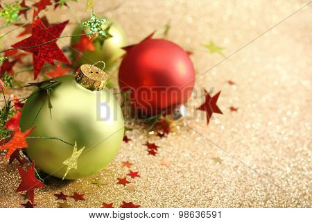 Christmas balls on golden background