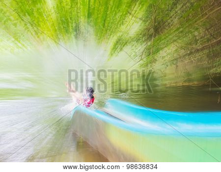 The Girl Sliding To The River,motion Blur
