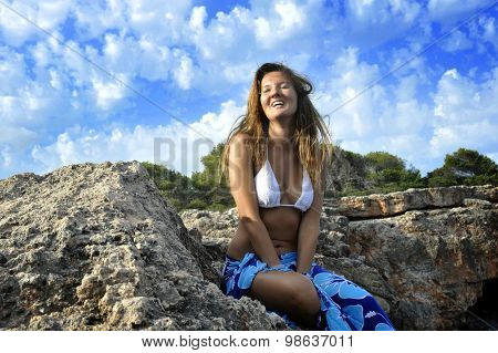 Woman At Coast Looking On Ocean Horizon In Rock Cliff By Sea Shore In Sarong Beach Wrap