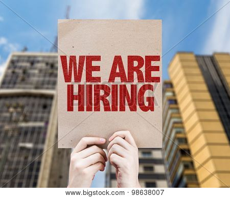 We Are Hiring card with urban background
