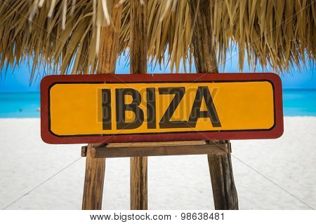 Ibiza sign with beach background