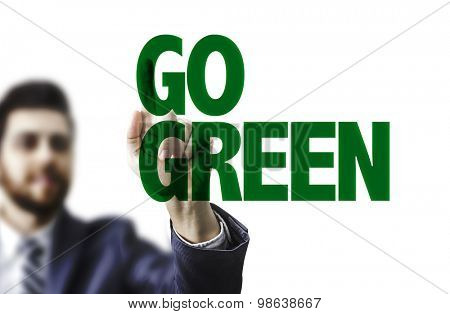Business man pointing the text: Go Green