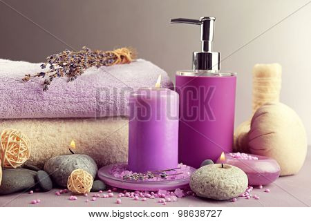 Spa treatments isolated on colorful background. Lavender spa concept