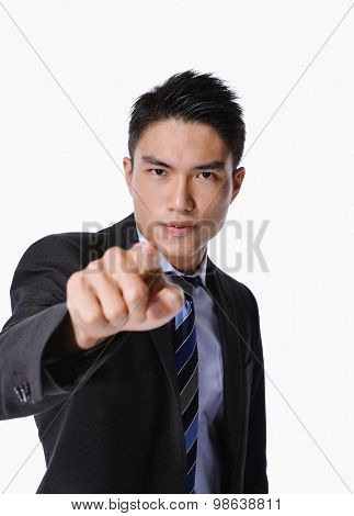 Portrait of young asian businessman pointing up-isolated