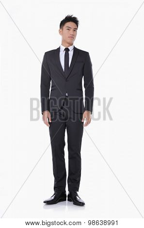 Full body young businessman. Vertical shot.