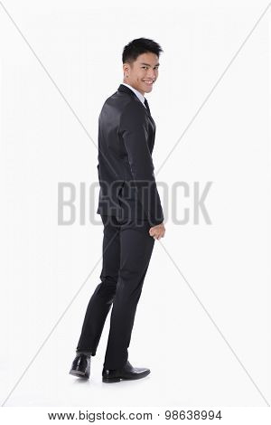 Back view of full body young business man.