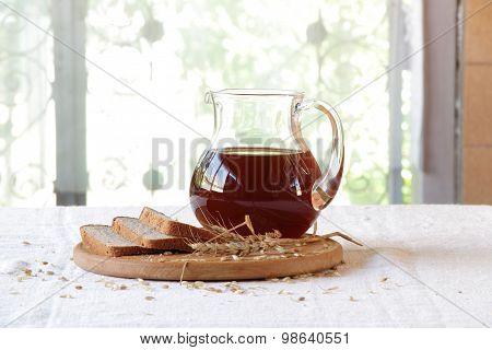Kvass (kvas) In A Transparent Jug And Rye Bread