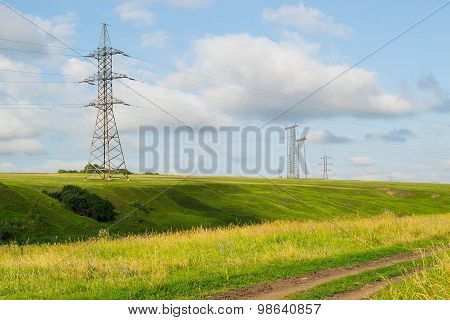 High-voltage Line Among Meadows And Fields