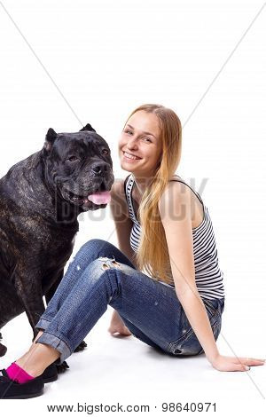 Girl Sitting And Smile  Next To His Dog Cane Corso