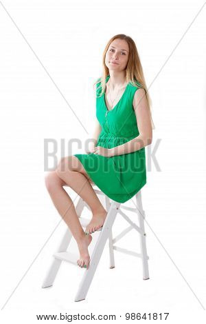 Girl In A Green Dress Sitting On Stepladder