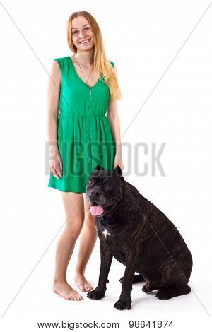 Girl In Green Dress Standing Next To A Large Dog Cane Corso