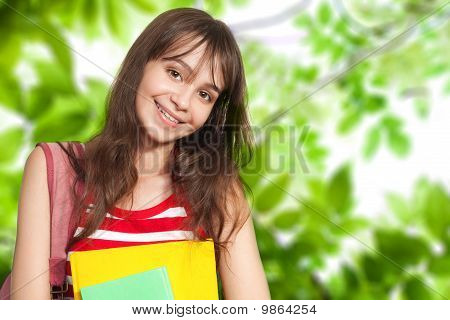 Teenage Girl With Books Outside