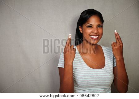Young Female Wishing With Fingers Crossed