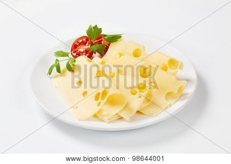 thin slices of emmental cheese on white plate