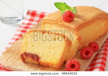 sliced pound cake and fresh raspberries