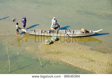 People load boat with vegetables in Bandarban, Bangladesh.