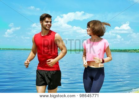 Young people jogging on beach