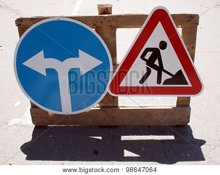 Two Road Signs Low Wooden Stand
