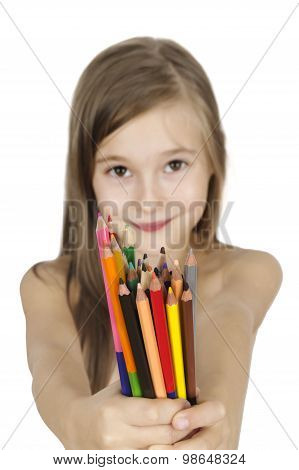 Portrait Of A Posing Young Girl Holding Color Pencils Isolated Over White