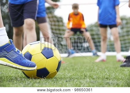 Close Up Of Children's Feet In Soccer Match
