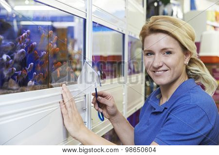 Portrait Of Female Employee In Pet Store