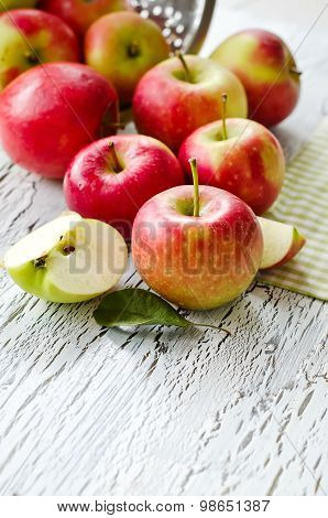 Red Fresh Apples From Garden With Leaves On White Wooden Background Copy Space